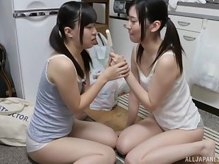 Lesbian action with Miyazawa Yukari and her girlfriend sharing an icecream