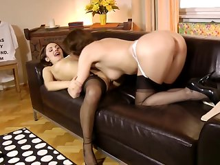 Classy lingerie cougar pleasuring young pussy