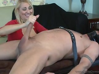 A full-bosomed older woman strokes a tumescence and rides it