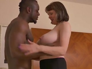 Big-Chested mature gal takes a immense dark-hued jizz-shotgun