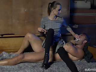 Mistress Adelle Unicorn gives a blowjob and tugjob to one cuffed dude